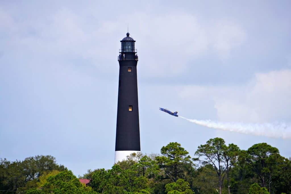 Blue Angels flying by light house