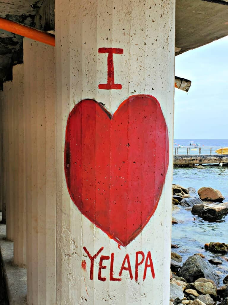 I Love Yelapa painted on post