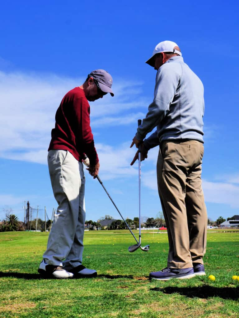man giving golf lessons