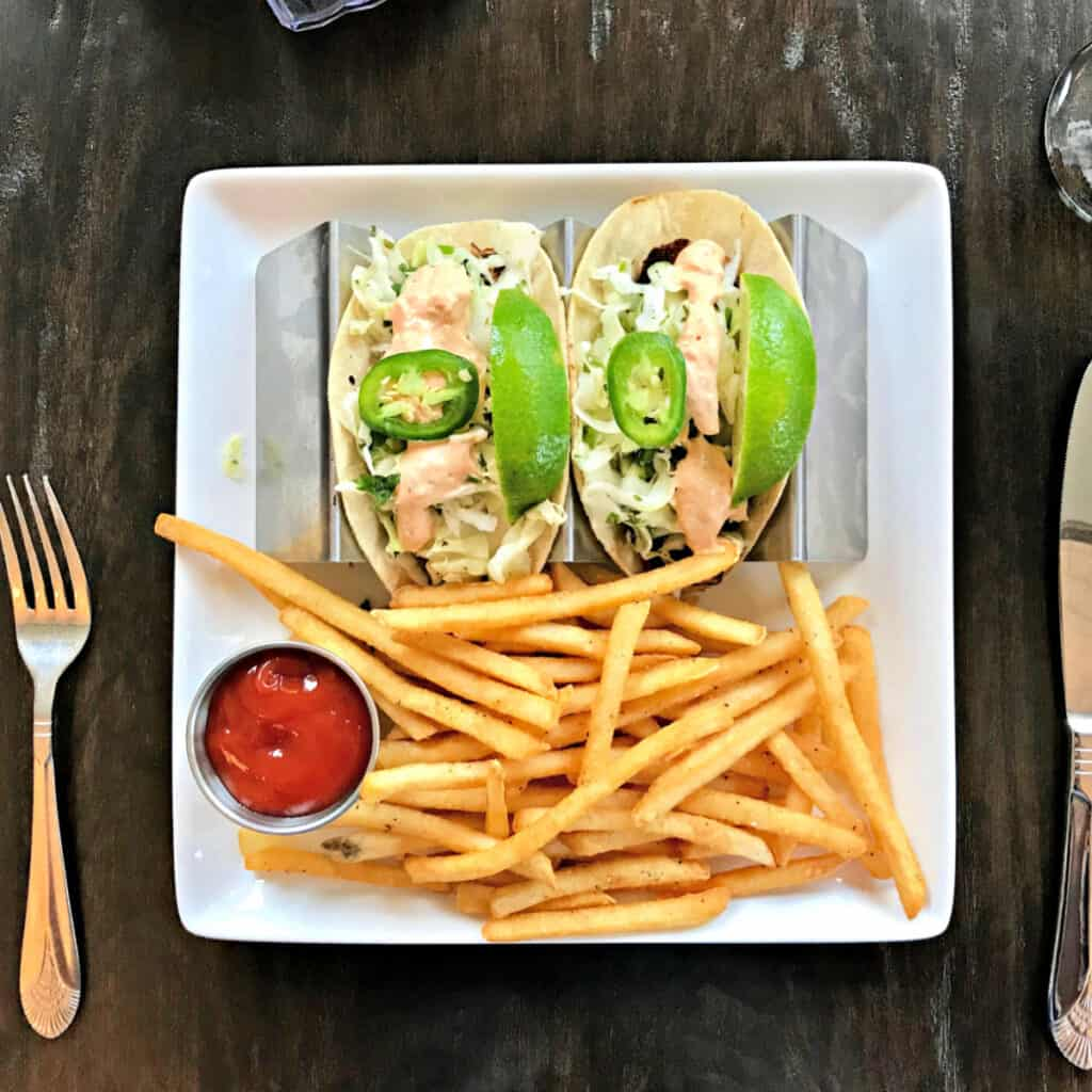 plate with fish tacos and French fries