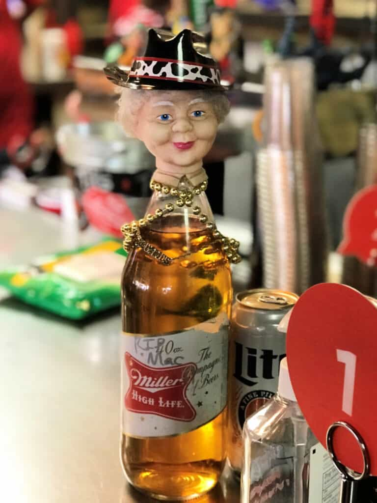 beer bottle with head on top