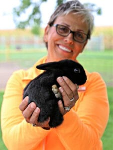 lady holding black bunny