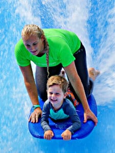 lady and child on boogie board