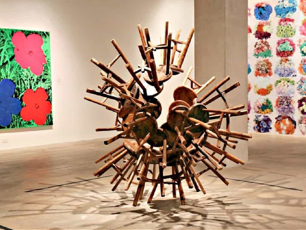 sculpture made out of chairs