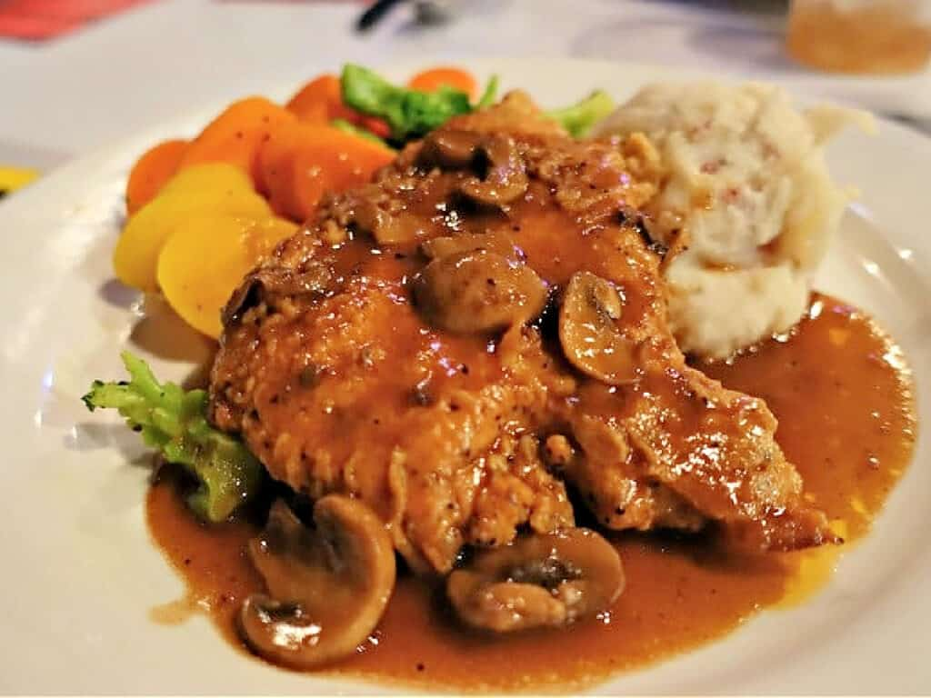 chicken dinner with mashed potatoes and vegetables