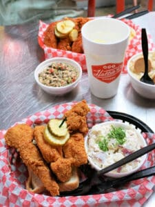 basket of hot chicken and potato salad