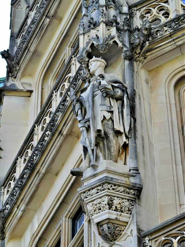 knight sculpture on building