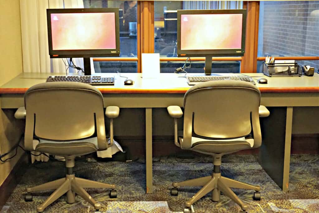 two computers and chairs
