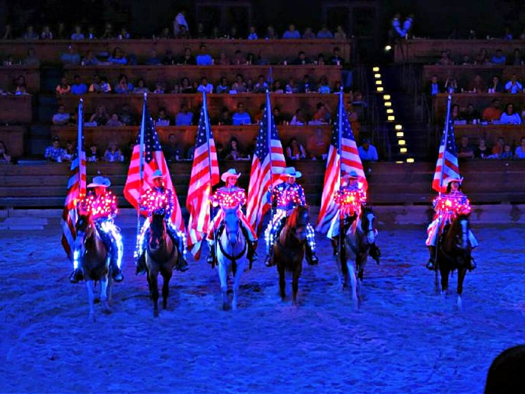 people in red, white, and blue on horseback