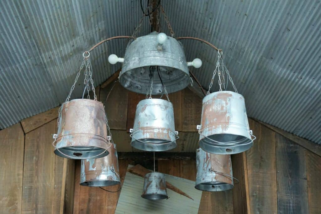 rustic chandelier made from metal buckets