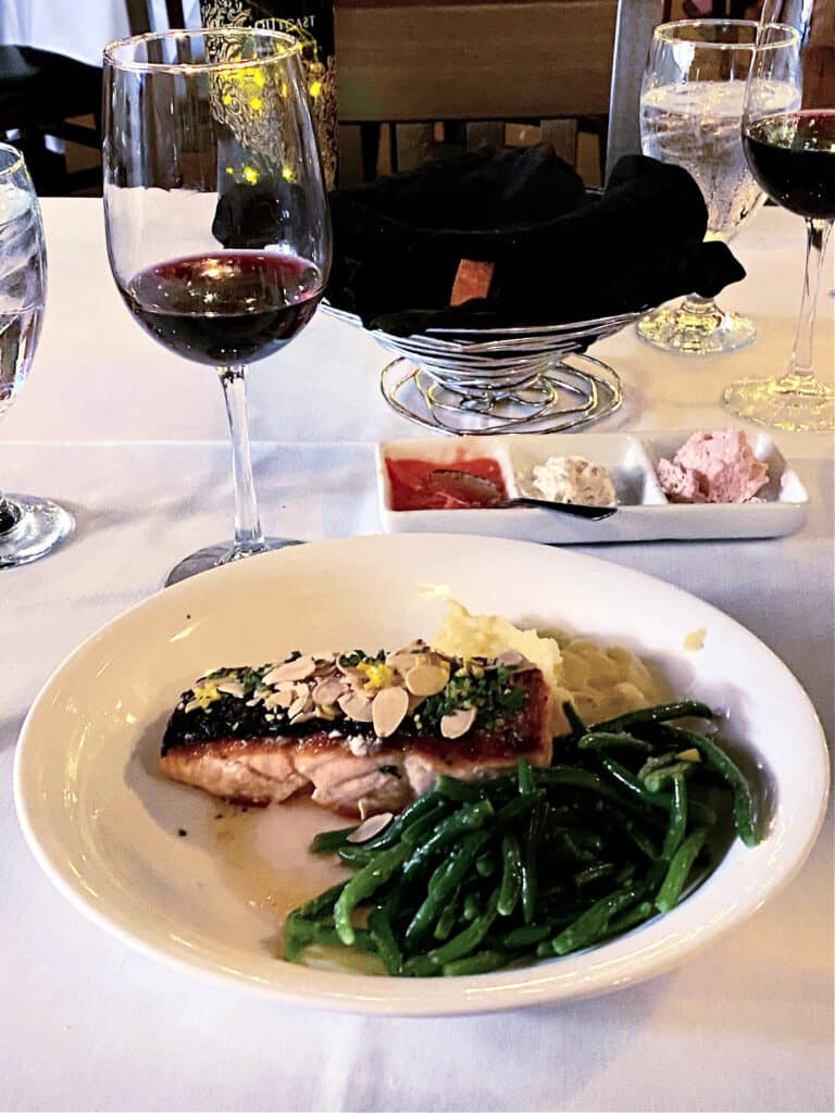 salmon dinner with green beans and red wine