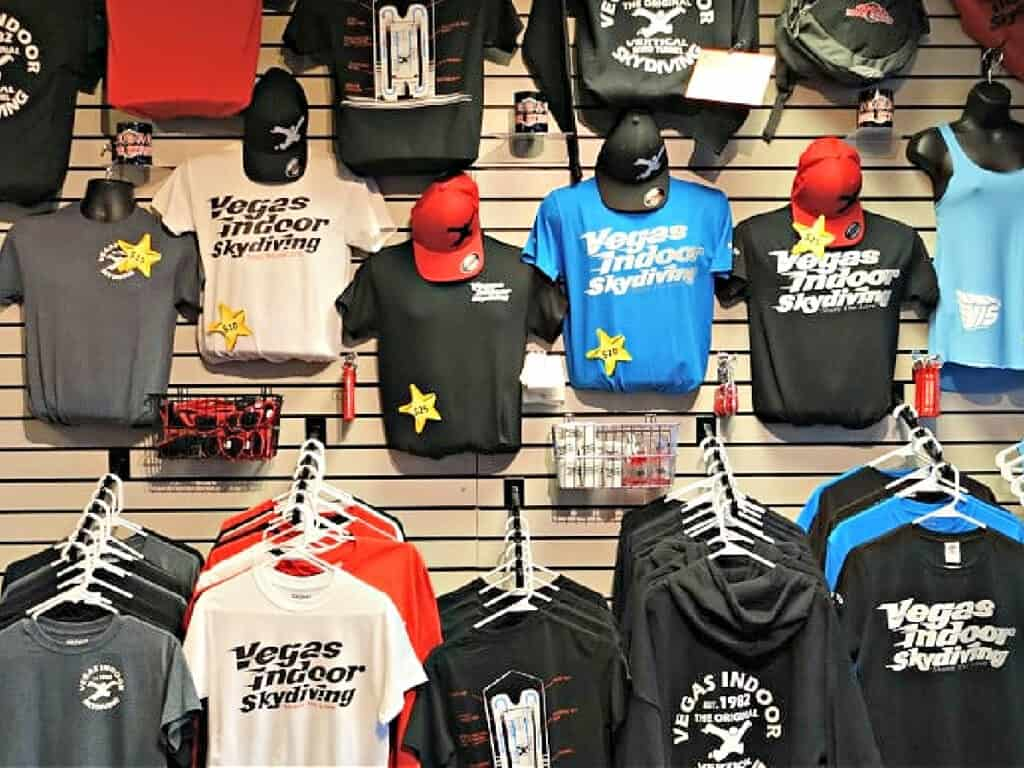 Vegas Indoor Skydiving shirts on a wall
