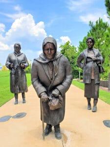 statue of three women