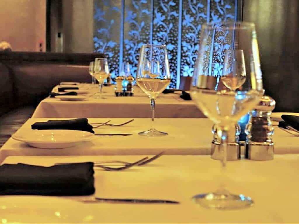 table with water glasses and silverware