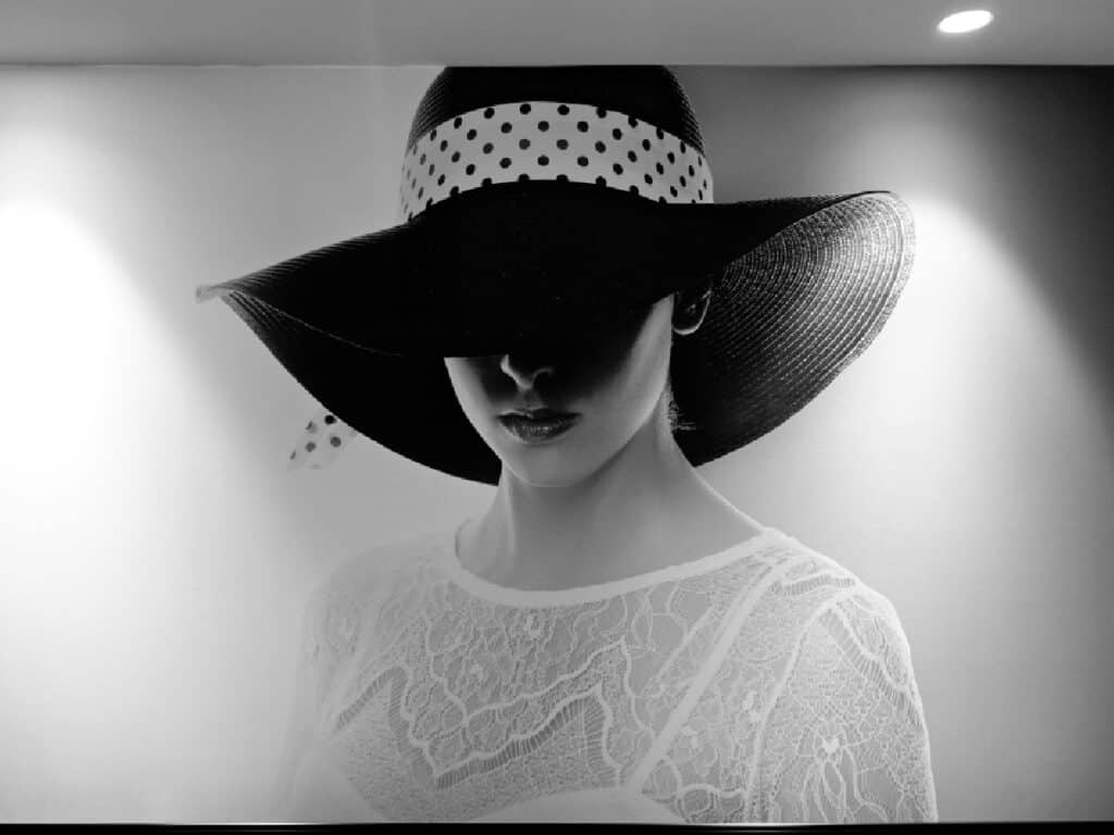 black and white photo of lady wearing a hat