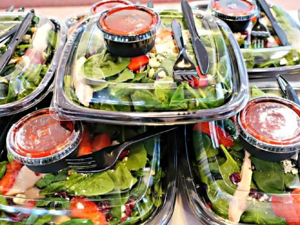 stack of salads and salad dressing