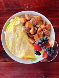 Decatur omelette with roasted potatoes and fresh fruit cup