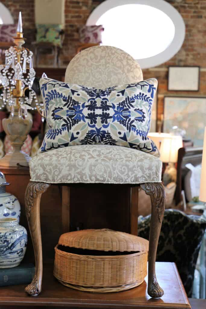 chair with a pillow sitting on top of a table