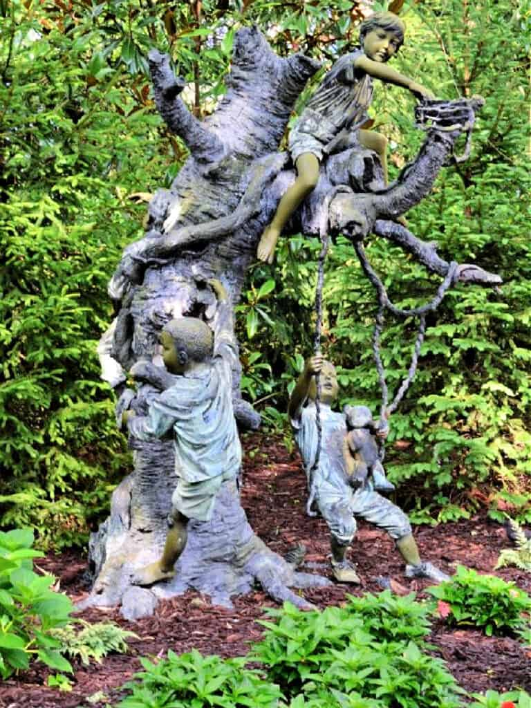 tree sculpture with children playing