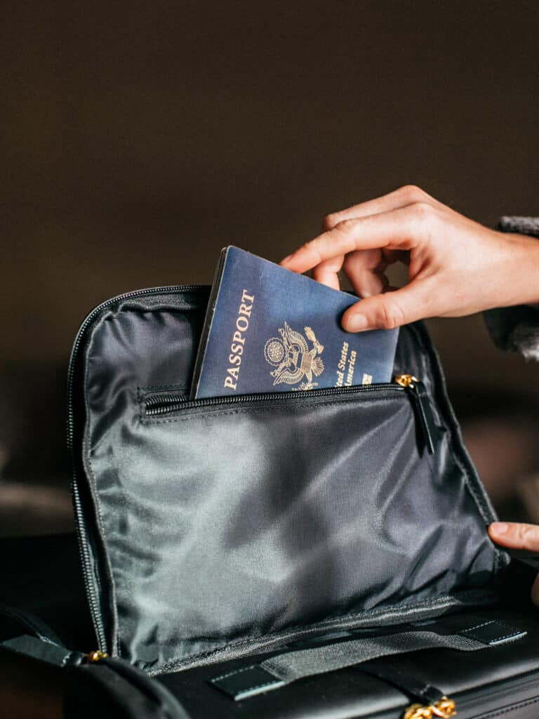 placing a passport in a purse