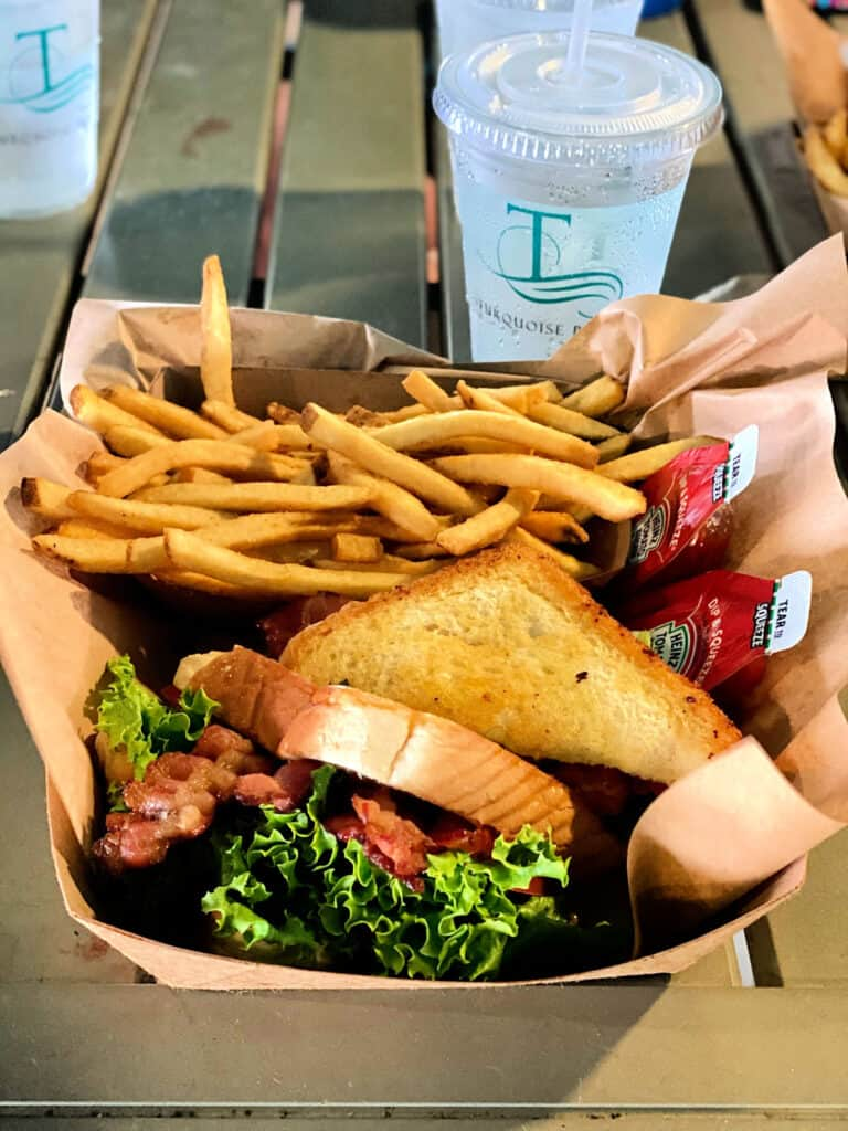 BLT sandwich, French fries, and cup of water