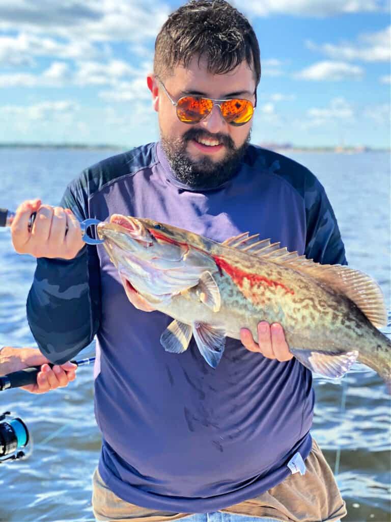 Trevor holding a grouper