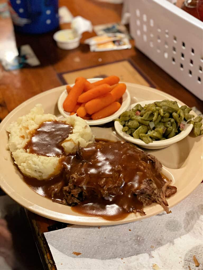 roast beef with mashed potatoes and gravy, green beans, and carrots