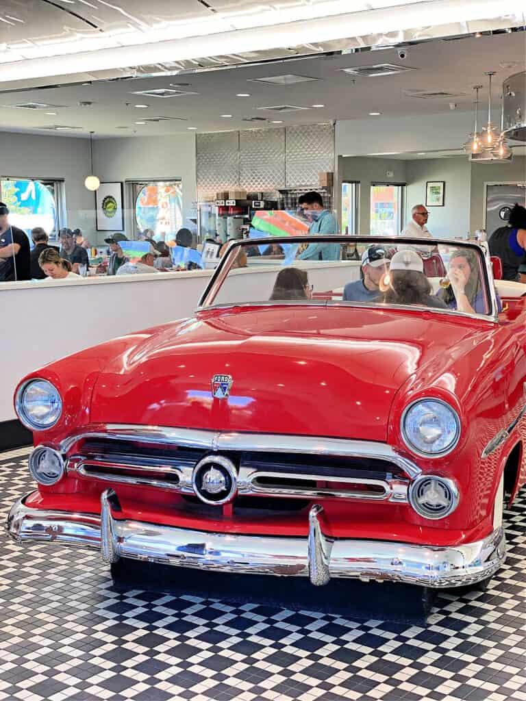 antique car inside a restaurant
