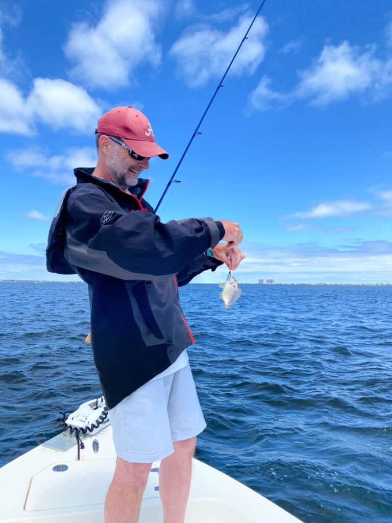 Jeff holding a small saltwater fish