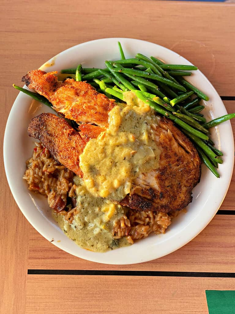 triple tail dinner with Cajun rice and green beans
