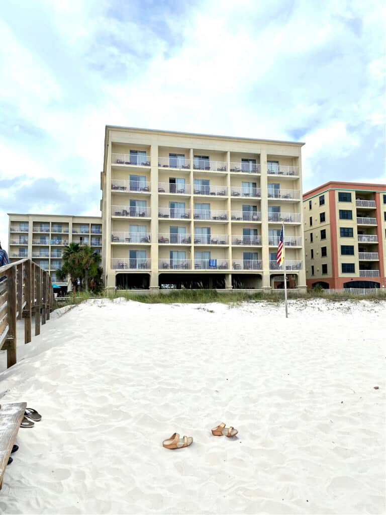 View of the back of Hilton Garden Inn and sand.