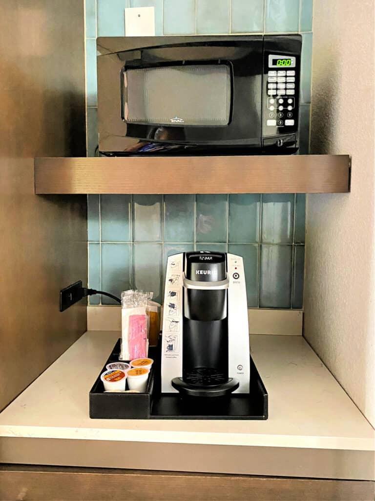 Mini Keurig coffee maker and microwave oven.