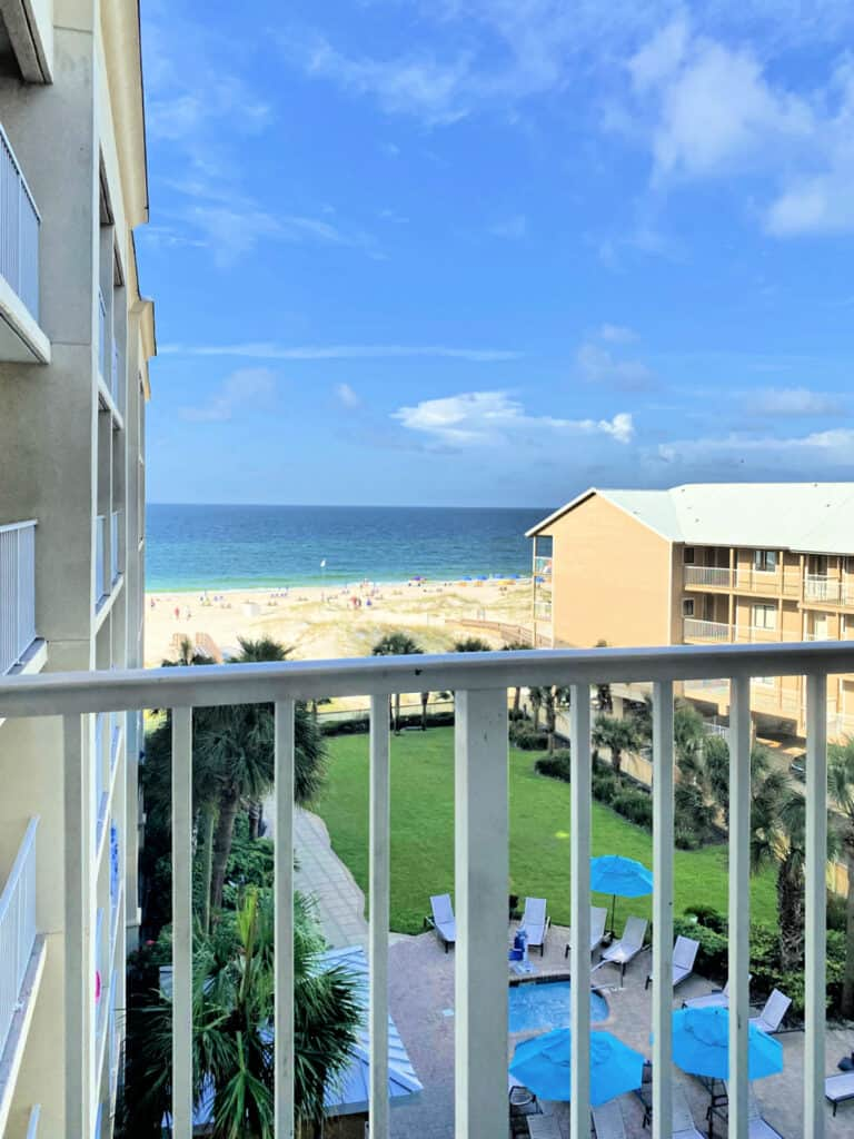 View from a balcony looking at the Gulf of Mexico and beach.