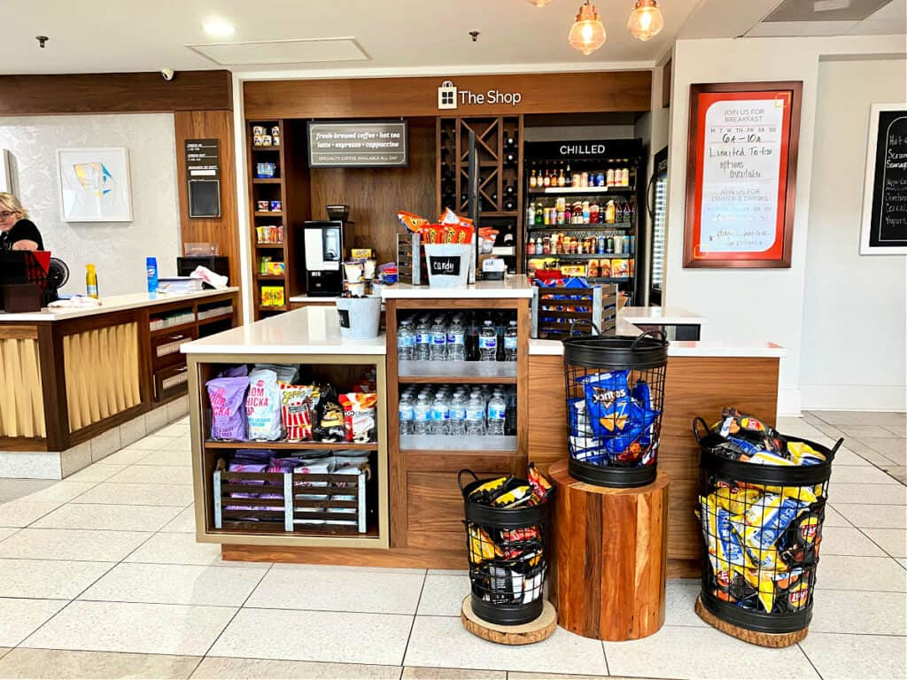 The Shop inside Hilton Garden Inn selling water and snacks.