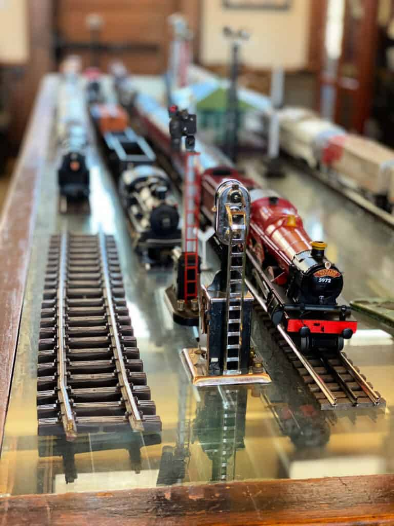 Model trains and railroad track on a table.