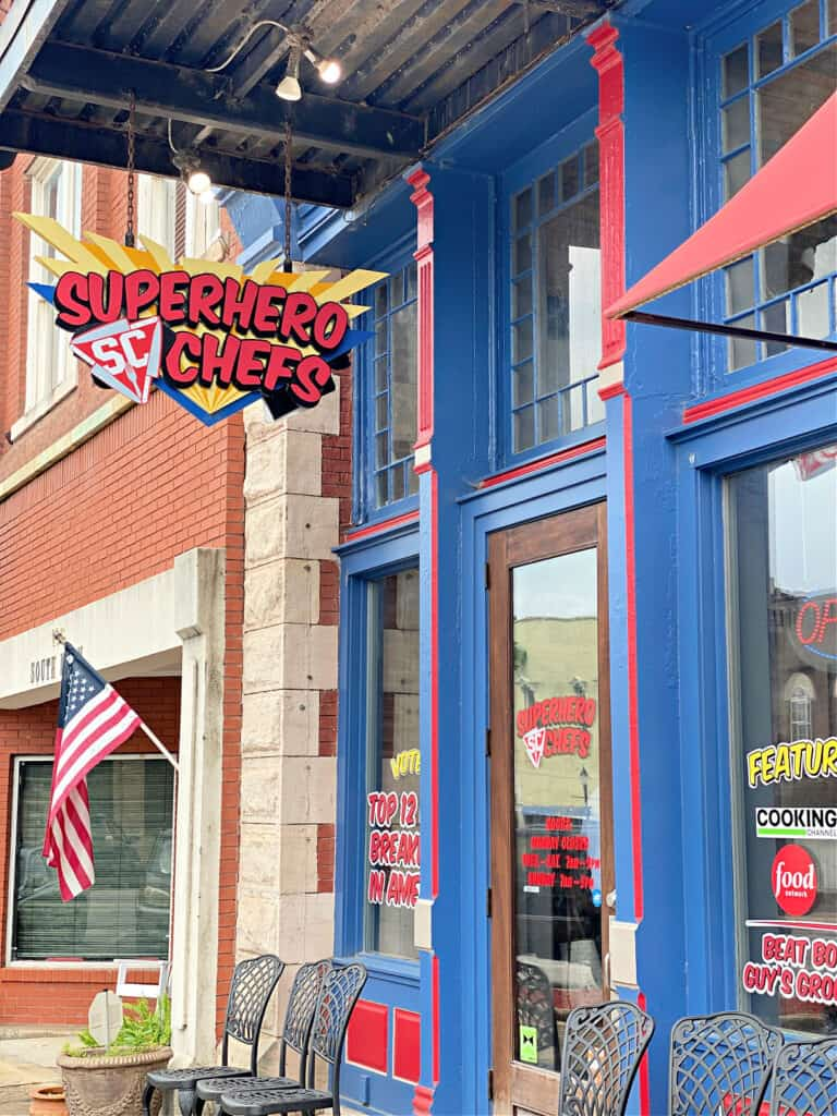 Blue and red painted front of Superhero Chefs building.