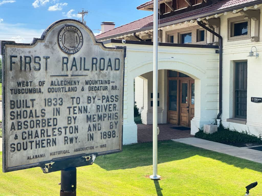 Railroad station sign and building.