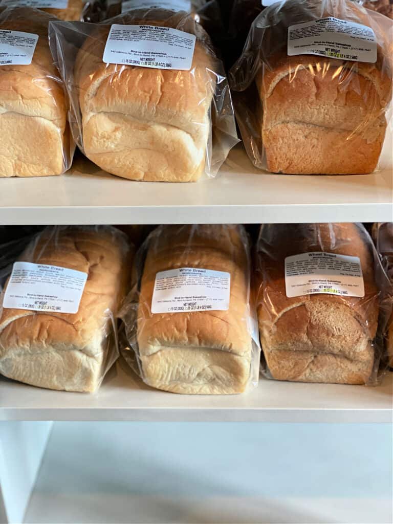 Six loaves of fresh baked Amish bread for sale.