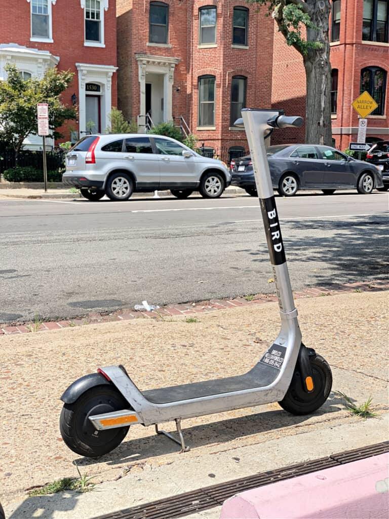 Bird electric scooter on a sidewalk in Washington, DC.