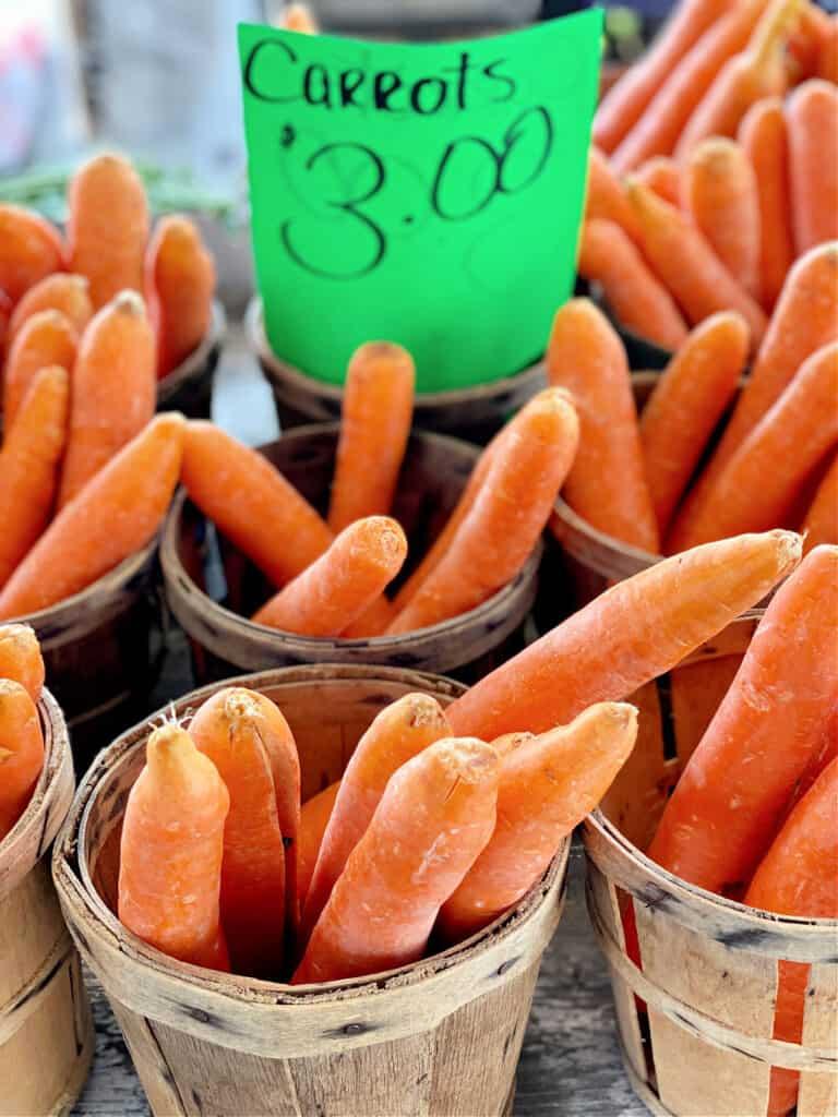 Basket of carrots for sale.