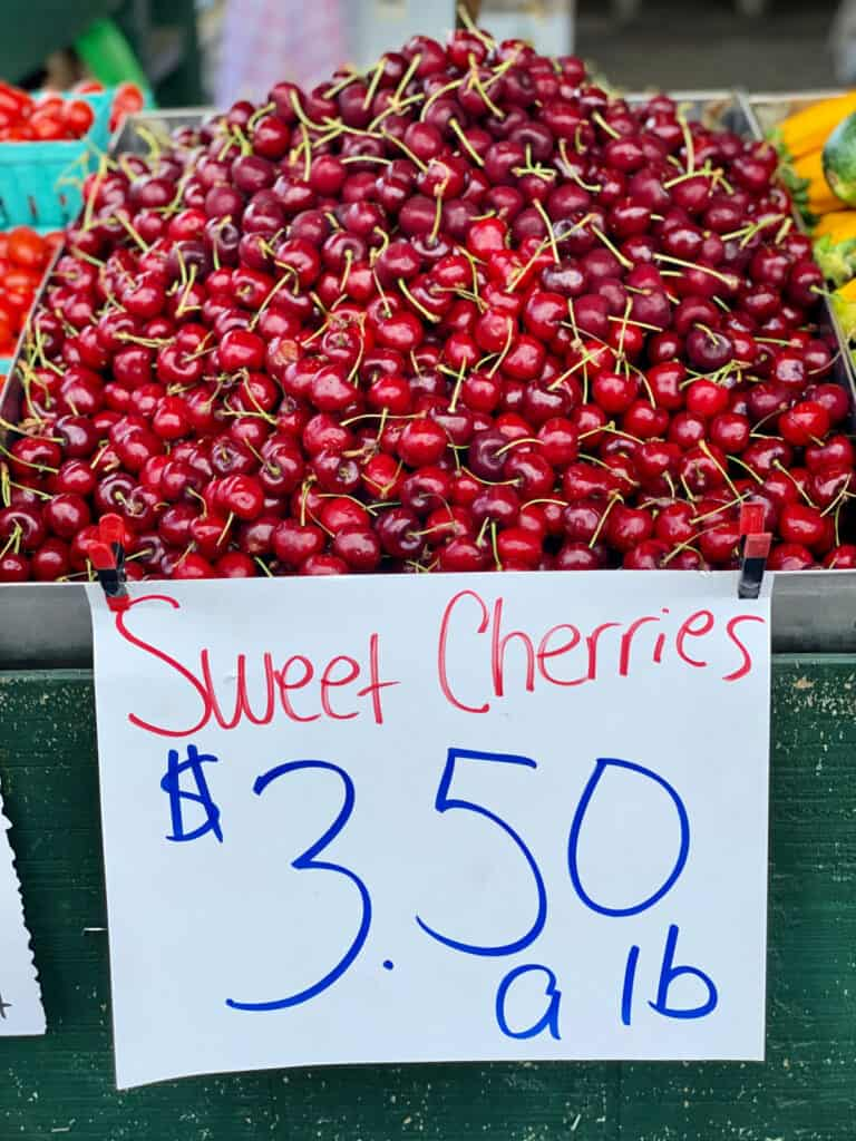 Stack of sweet cherries for sale.