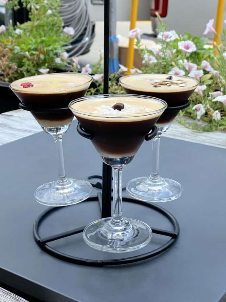 Three coffee martinis on a stand.