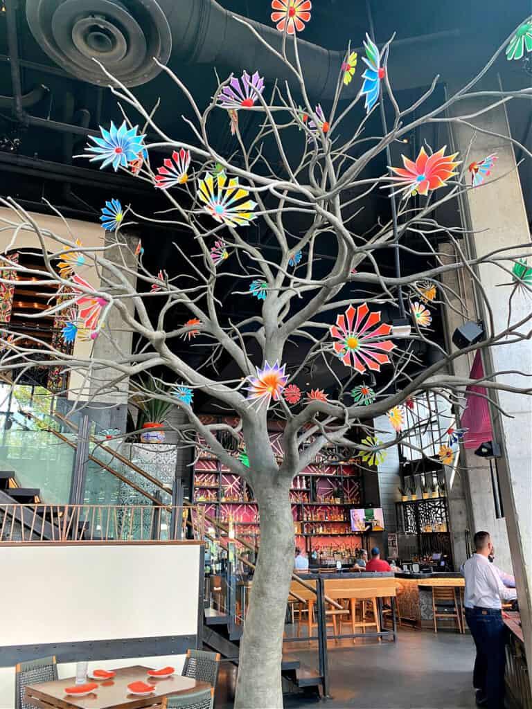 Tree sculpture inside a restaurant.