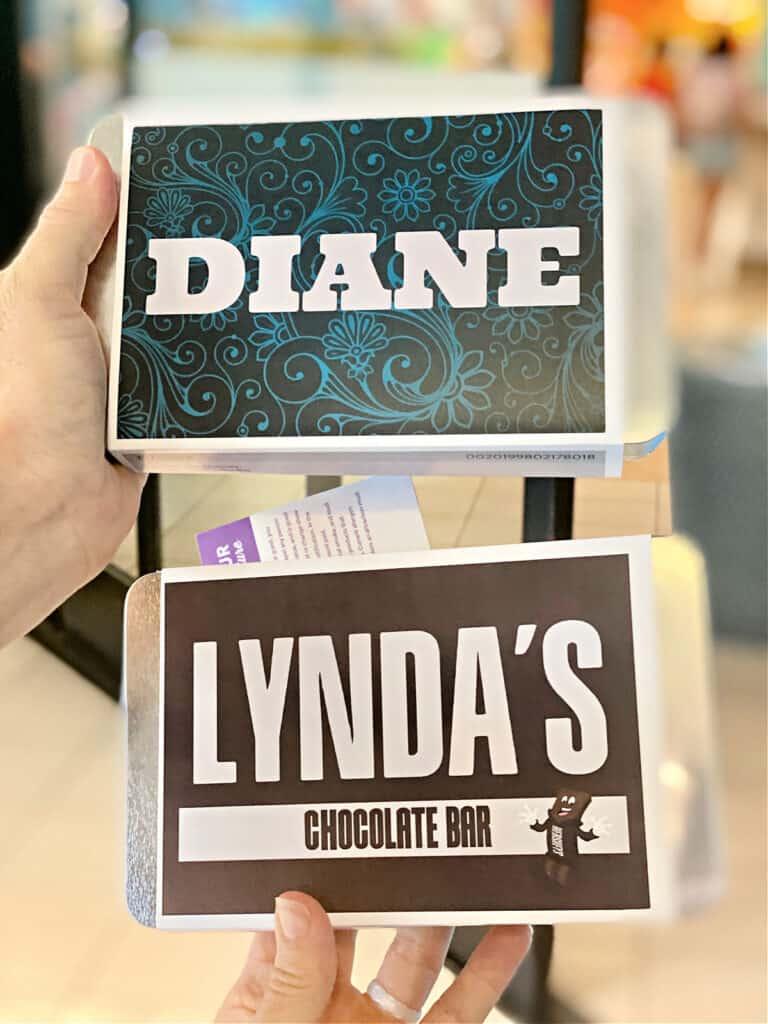 Women holding custom made chocolate bars at Hershey's.