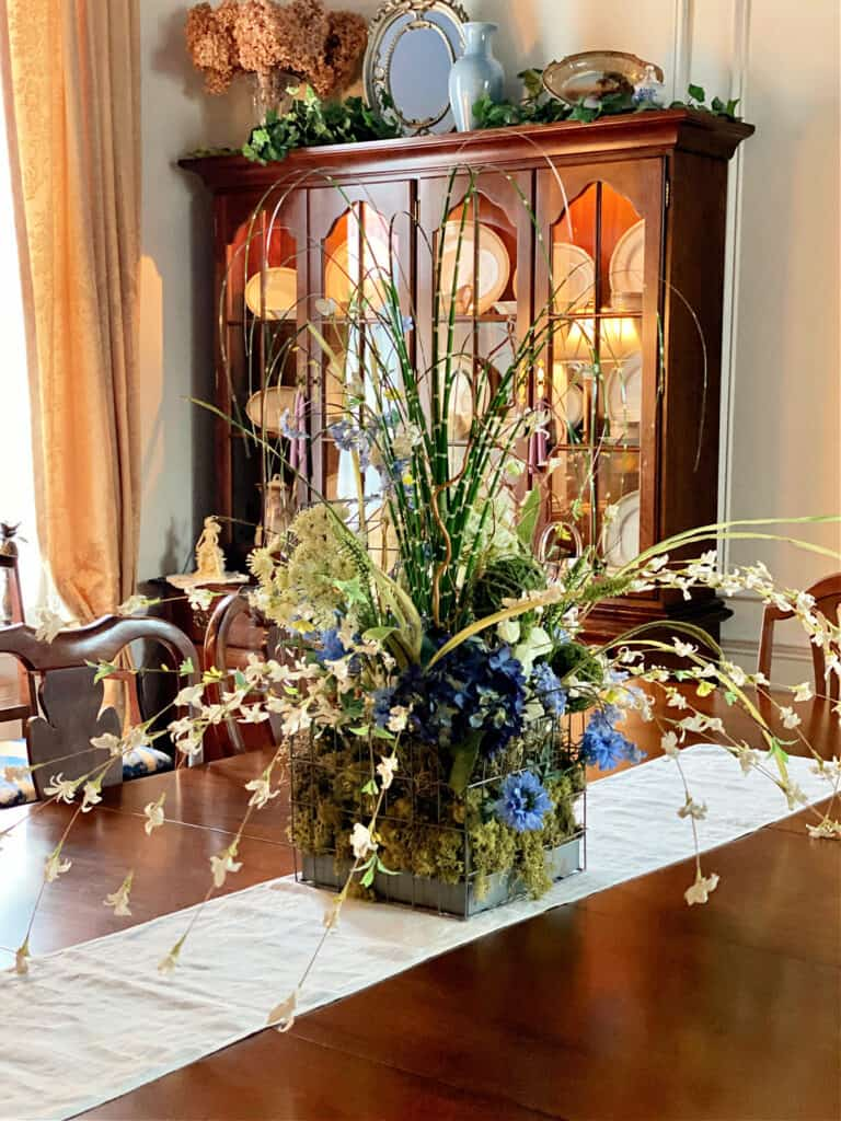 Dining room table with floral centerpiece.