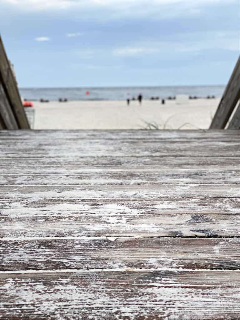 Wooden boardwalk leading to beach and Gulf of Mexico.