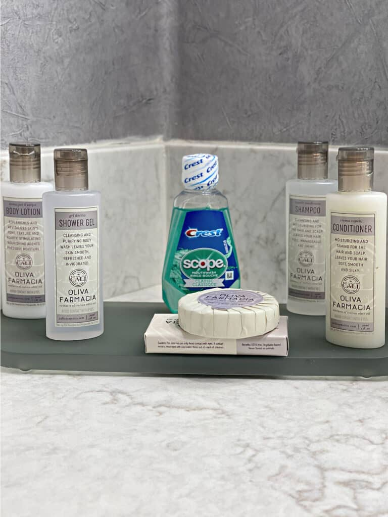 Hotel toiletries including mouthwash and soap.
